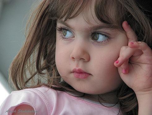 تقبيل الأطفال فى الفم يعمل على نقل الميكروبات