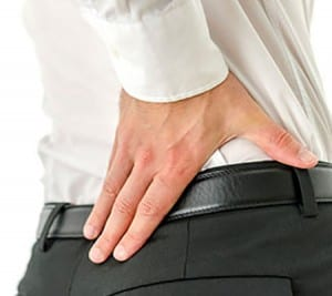 Detail of businessman with back pain.